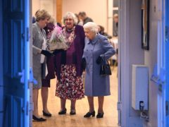 The Queen (right) leaves after attending a Sandringham Women's Institute (WI) meeting at West Newton Village Hall, Norfolk (Joe Giddens/PA)