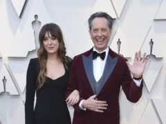 Richard E Grant and Bradley Cooper among stars with family members at the Oscars (Richard Shotwell/AP)