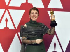 """Olivia Colman poses with the award for best performance by an actress in a leading role for """"The Favourite"""" in the press room at the Oscars on Sunday, Feb. 24, 2019, at the Dolby Theatre in Los Angeles. (Photo by Jordan Strauss/Invision/AP)"""