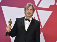 The director of Oscar-winning Green Book has defended the film as having a 'hopeful message' amid criticism of its handling of race (Jordan Strauss/Invision/AP)
