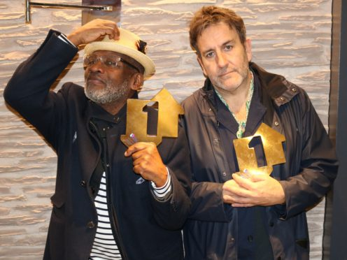 Lynval Golding and Terry Hall of The Specials with their Official Number 1 Album Award for Encore (credit: © OfficialCharts.com)