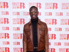 J Hus made a surprise appearance on stage at the O2 with Canadian star Drake (Ian West/PA)