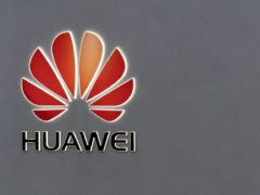 It has been reported that Theresa May is to permit Huawei to supply 'non-core' elements to the 5G system (Steve Parsons/PA)