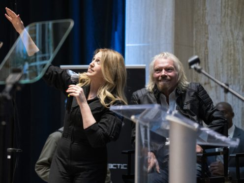 Beth Moses, chief astronaut instructor, describes her flight into space while on stage with Virgin Galactic founder Sir Richard Branson (Craig Fritz/AP)