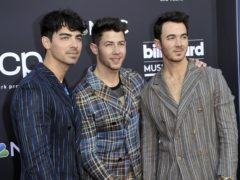 The Jonas Brothers will release a memoir later this year, the band has announced (Richard Shotwell/Invision/AP, File)