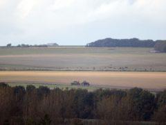 Tractors work on fields (Steve Parsons/PA)