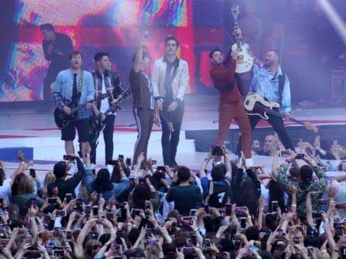The Jonas Brothers and Busted erform Year 3000 on stage during Capital's Summertime Ball (Isabel Infantes/PA)