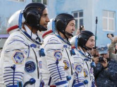 Hazza Almansoori, Oleg Skripochka and Jessica Meir, members of the main crew of the expedition to the International Space Station (Dmitry Lovetsky/AP)
