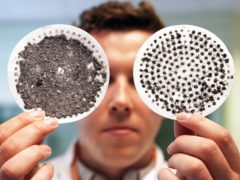 Newcastle University PHD student Max Kelly views washing machine filters, one with microfibres collected following a delicate wash (left) compared with a filter from a normal wash cycle showing less collected microfibres (Owen Humphreys/PA)