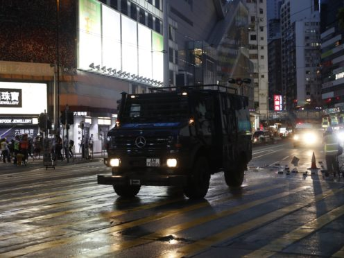 A police armoured vehicle in Hong Kong (Vincent Thian/AP)