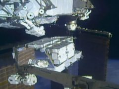 Nasa astronauts Christina Koch and Andrew Morgan work outside the International Space Station (Nasa via AP)
