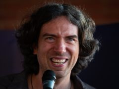 EMBARGOED TO 0001 WEDNESDAY JULY 17 Frontman of Snow Patrol Gary Lightbody receives the award for Most Played song of the 21st century, according to music licensing company PPL for his band's record, Chasing Cars, at the Oxo Tower, London.