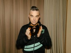 Robbie Williams has scored his 13th number one album with The Christmas Present (Leo Baron/Official Charts Company/PA)