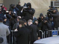 Harvey Weinstein, centre, walks by the media on his way into a Manhattan courthouse (Mark Lennihan/AP)