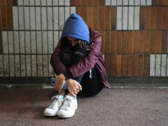 A teenage girl showing signs of mental health issues (Gareth Fuller/PA)