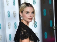 Margot Robbie says she has known Harry for some time (PA)