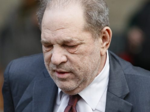 A British woman who alleges she was sexually assaulted by Harvey Weinstein has admitted to feeling 'torn' after he was acquitted of some of the charges he faced (John Minchillo/AP)