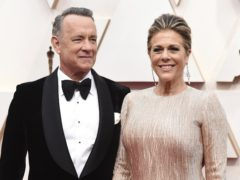 Tom Hanks and wife Rita Wilson have left hospital and are self-isolating in Australia after testing positive for coronavirus (Jordan Strauss/Invision/AP)