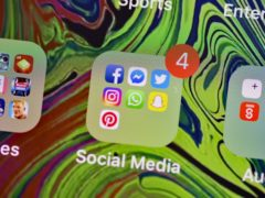 Social media app icons on a smartphone (PA)