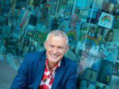 Jeremy Vine with rainbow pictures sent in by viewers of his Channel 5 show (Dominic Lipinski/PA)