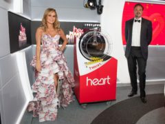Amanda Holden and Jamie Theakston gave the good news on Heart Breakfast (Heart/PA)