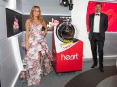 Amanda Holden and Jamie Theakston gave the good news on Heart Breakfast (Heart/PA)