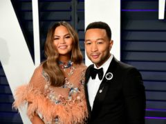 Chrissy Teigen and John Legend cheered Joe Biden's running mate (Ian West/PA)