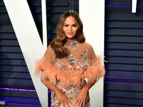 Pregnant Chrissy Teigen appeared to accidentally reveal she and husband John Legend are expecting a boy (Ian West/PA)