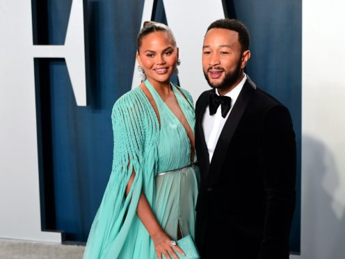 Chrissy Teigen has recalled the 'horrifying' moment she and husband John Legend were followed and harassed by two white men (Ian West/PA)