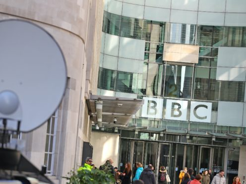 Media trucks outside BBC Broadcasting House (Aaron Chown/PA)