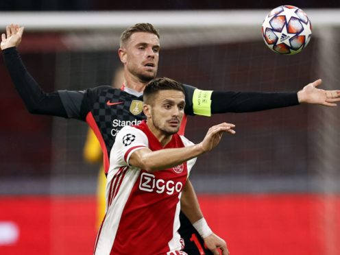 Dusan Tadic (front) was on target as Ajax chalked up a record-breaking victory (PA Wire via ANP)