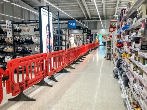"""The clothing area in a supermarket near Cardiff is deemed non-essential items and is cordoned off as Wales entered a two-week """"firebreak"""" lockdown (Ben Birchall/PA)"""