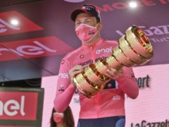 Britain's Tao Geoghegan Hart holds the trophy after winning the Giro d'Italia (Luca Bruno/AP)