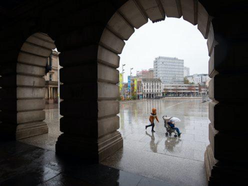 Rain falls in the Old Market Square in Nottingham (Joe Giddens/PA)