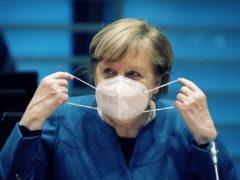 Angela Merkel believes the German health system could be overwhelmed without action (Kay Nietfeld/dpa via AP, pool)