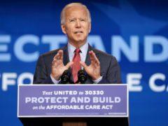 Joe Biden speaks about coronavirus and health care at The Queen theatre in Wilmington (Andrew Harnik/AP)