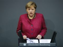 German Chancellor Angela Merkel delivers a speech about German government's policies to combat the spread of the coronavirus (Markus Schreiber/AP)