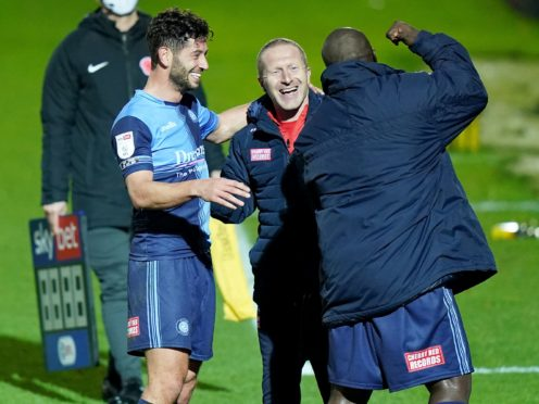 Assistant manager Richard Dobson celebrates Wycombe's historic win (Tess Derry/PA)
