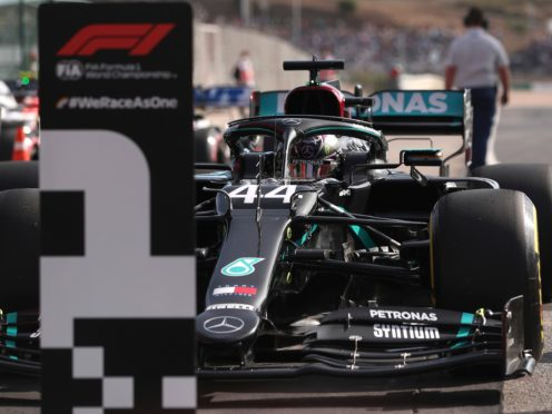 Lewis Hamilton securing his 97th career pole on Saturday (Jose Sena Goulao/AP)