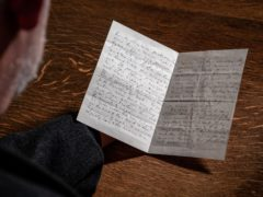 Canon Librarian, the Rev Dr Peter Doll, with Edith Cavell's last letter to her mother, which has been donated to Norwich Cathedral. (Norwich Cathedral/Bill Smith/PA)