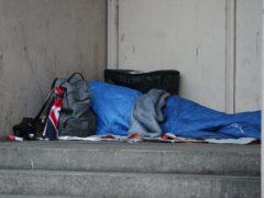 A homeless person sleeping rough in a doorway in Farringdon, London (Yui Mok/PA)
