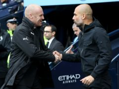 Sean Dyche (left) and Pep Guardiola will lock horns again on Saturday (Martin Rickett/PA)