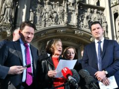 Geraldine Finucane, the widow of murdered Belfast solicitor Pat Finucane, accompanied by her sons John (right) and Michael (left) (PA)