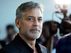 George Clooney has confirmed he once gave 14 of his closest friends a million dollars (£754,000) each in cash (Ian West/PA)