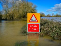 A flood warning sign (Ben Birchall/PA)