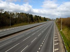 People in professional occupations were among the most likely to be driving fewer miles (Tim Goode/PA)