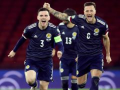 Andrew Robertson (left) hopes to lead his side out at Hampden next summer (Andrew Milligan/PA)
