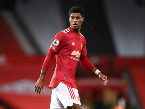 Marcus Rashford has drawn praise for highlighting the issue of child food poverty, but his club Manchester United have been urged to pay staff the living wage (Michael Regan/PA)