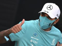 Lewis Hamilton, gives the thumbs up as he celebrates winning the Emilia Romagna Grand Prix but says he cannot guarantee racing on in 2021 (AP Photo/Luca Bruno, Pool)