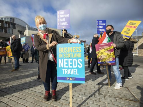 Travel agents and SPAA members protest outside the Scottish Parliament (Jane Barlow/PA)